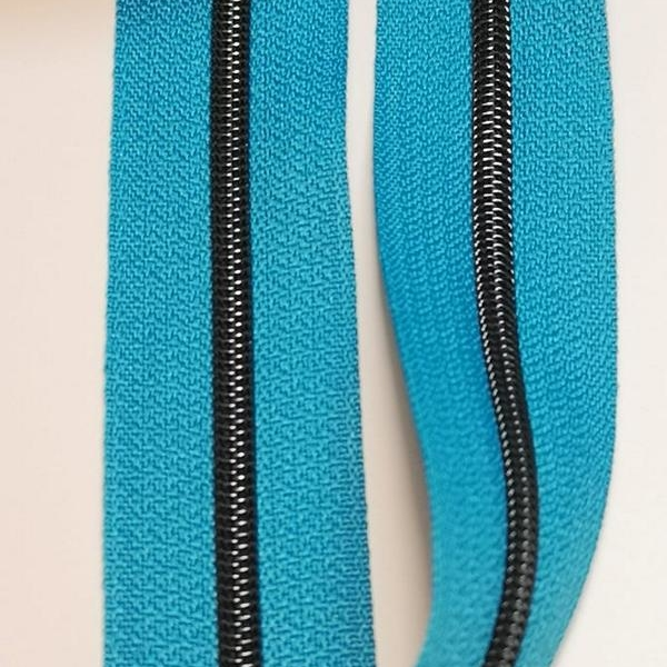 Metallized zipper 108 January blue turquoise dark narrow brass-black Stoffdreams4you