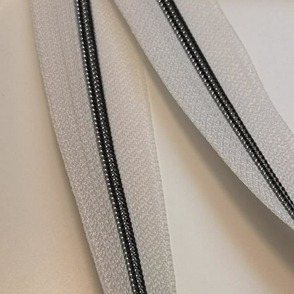Metallized zipper pure white 311 cream 010 both narrow brass-black Stoffdreams4you 1